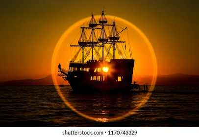 Sunset ship silhouette view. Ship sunset silhouette panorama. Sunset ship silhouette background