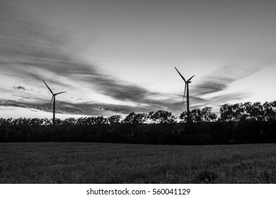 Sunset showing wind turbine silhouette with high contrast clouds