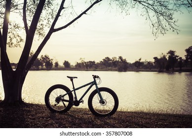 sunset silhouette of fat bike bicycle