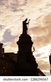 Sunset silhouette of the historic 1908 monument statue of Bishop Francois de Laval in Old Quebec city, Canada. He was the first Roman Catholic bishop of Quebec.