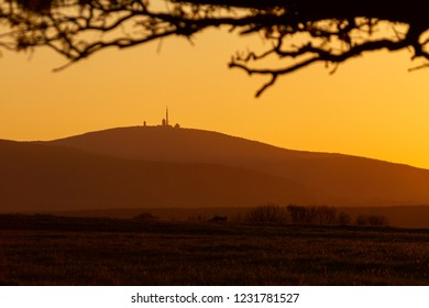Sunset with Silhouette of mount Brocken in the late summer