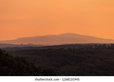 Sunset with Silhouette of the mountain Brocken Harz