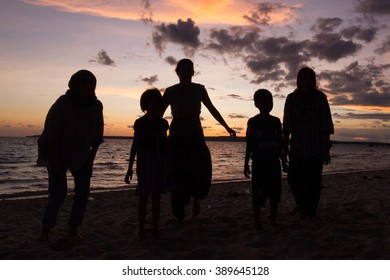 Sunset with silhouette of people
