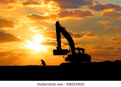 Sunset and Silhouette of Power shovel.