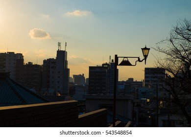 Sunset silhouette view at Yanaka Ginza is traditional shopping street, The district is known for old town ambience reminiscent of Tokyo from past decades.