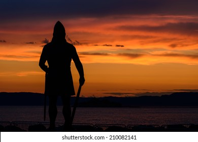 Sunset silhouette of a viking statue in Trondheim