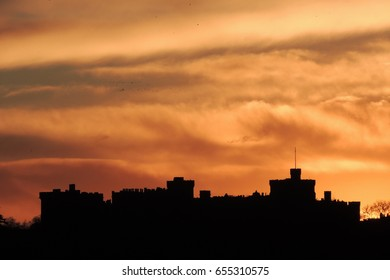 A sunset silhouette of Windsor castle, looking south from Slough in Berkshire