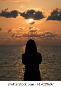 Sunset Silhouette with a Woman