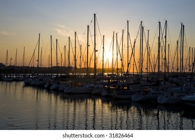 Sunset with the silhouettes of sailboats