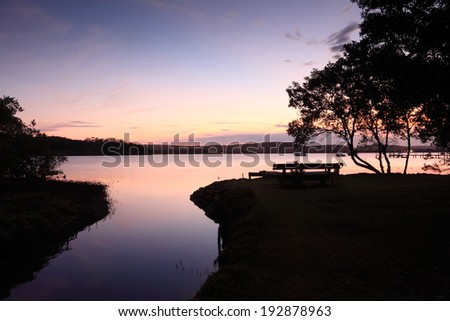 Sunset Silhouettes Where Kincumber Creek Meets Stock Photo (Edit Now