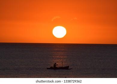 sunset and sinner in Majunga