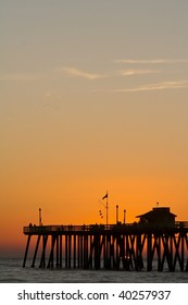 Sunset skies behind the pier