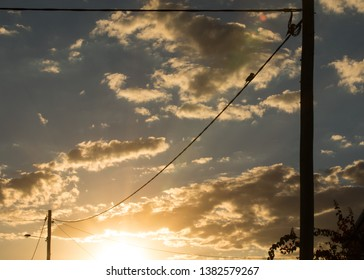 Sunset Skies in Outback Queensland on an Autumn Afternoon. Single Local Wildlife Bird on a powerlines.