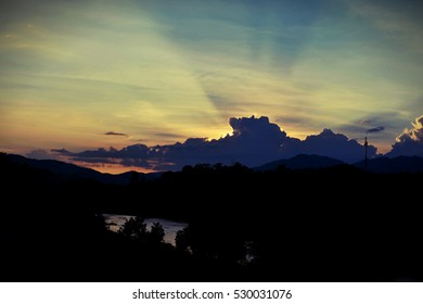 Sunset sky background with clouds and sun, photo image wallpaper.