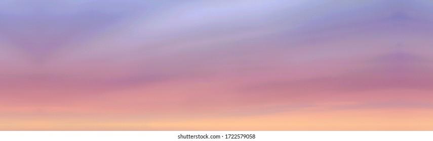 Sunset sky background. Colorful blue pink and light orange color sky texture. Sunset or sunrise nature landscape, skyscape natural background