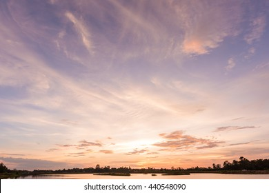 Sunset sky background with landscape of calm lake at sunset