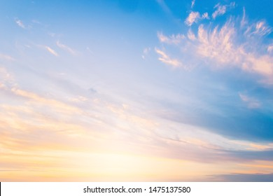 Sunset sky background on twilight in the evening,beautiful sunlight and colorful cloud fluffy,majestic peaceful nature background.