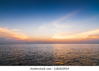 Sunset sky background over the sea. Nature background.
