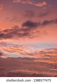 Sunset Sky Background with Pink and Orange Clouds