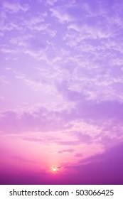 Sunset sky background. Purple filter