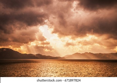 Sunset sky before storm with divine light at lake Tazawa, Semboku, Akita, Japan.