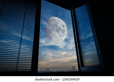 Sunset sky with big moon - view from window.