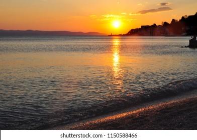 sunset sky by sea in Podgora, Croatia