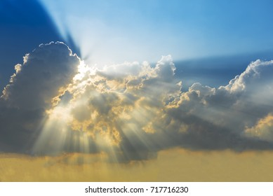 Sunset sky with cloud and sun ray. Nature background. Miracle, hope, or amazing nature concept.