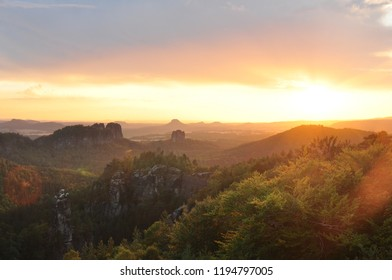 Sunset sky with clouds and beautiful landscape with hills silhoutte.
