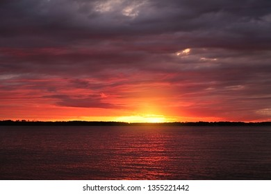 Sunset sky with clounds colors in a lake view, soft blurry background, Of free for your space and branding.