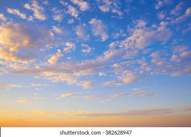 Sunset sky with golden and blue clouds in Mediterranean