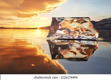 Sunset sky and ice on Lake Baikal. Winter ice on Lake Baikal. Crystal clear drinking water. The floe on Lake Baikal broke away and is reflected in the ice as in a mirror.