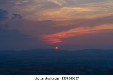 Sunset sky with mountains