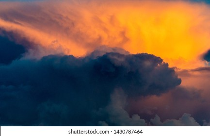 Sunset sky nature background. Dramatic evening bright heaven cloudscape. Scenic orange sunlight