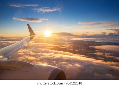 Sunset sky on airplane, plane window, over Copenhagen, Denmark, Scandinavia, Europe in Friday evening flight for relax in holiday
