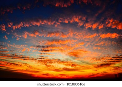 sunset sky with orang and red clouds