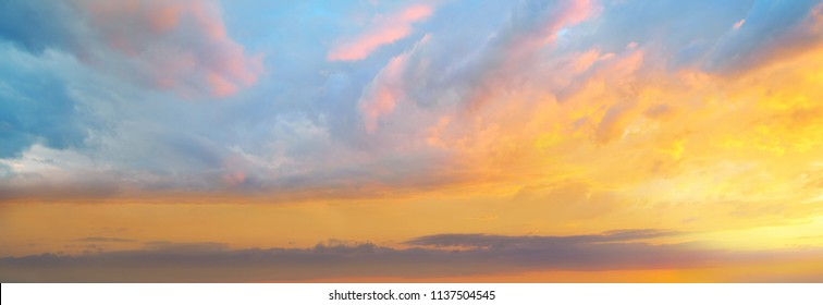 sunset sky in orange and blue blackground