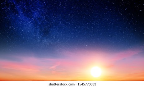 Sunset sky with orange setting sun and red clouds landscape against bright star on black universe background. Wide panorama view of stars in space nature at dark time. Starry night at night wallpaper