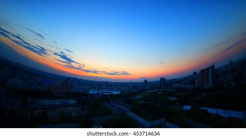 Sunset sky over a city. Ukraine, Kiev. A view of one of the central parts of the city. Effect -  fish eye lens.