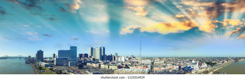 Sunset sky over New Orleans. Aerial view of city and river.