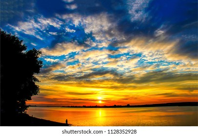 Sunset sky over water landscape. Sunset sky clouds over sunset river horizon panorama. Sunset river water view