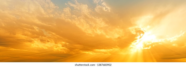 sunset sky panorama landscape background natural color of evening landscape with setting sun light coming through clouds panoramic view