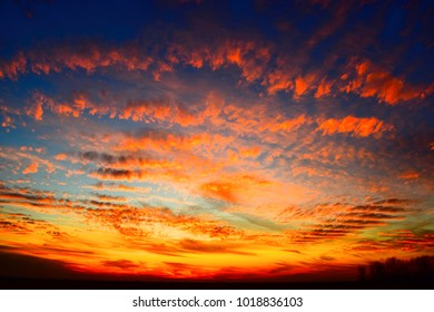 sunset sky with red and orange clouds