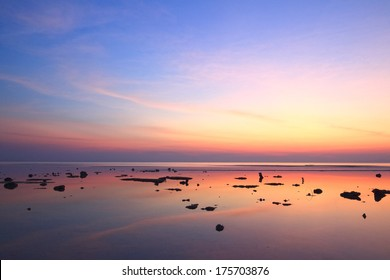 Sunset sky reflection over clear sea