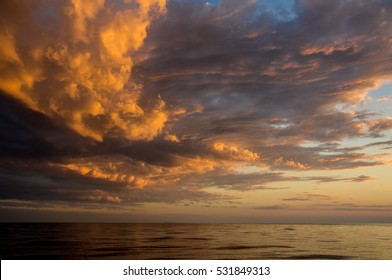 sunset sky from the sea perspective with the dramatic clouds