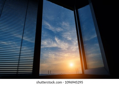 Sunset sky with stars - view from window.