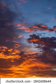 Sunset sky vertical with colorful sunlight on dark blue sky.