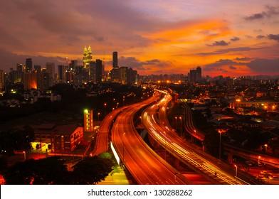 Sunset skyline of Kuala Lumpur city with Petronas Twin Towers or Kuala Lumpur City Centre (KLCC) as part of the skyline.