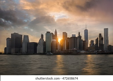 Sunset Skyline of New York - view of Brooklyn Bridge and buildings in Manhattan