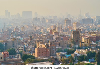 The sunset skyline of old Cairo from the Saladin Citadel, overlooking Al-Darb al-Ahmar - one of the poorest neighborhoods in city with numerous historic landmarks, Egypt.